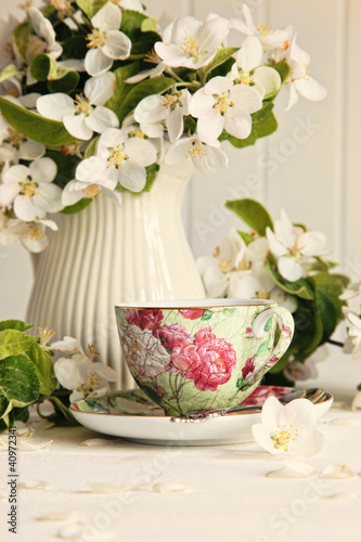 Tea cup with fresh flower blossoms