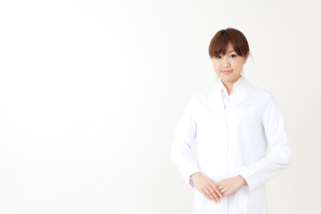 a portrait of asian woman wearing lab coat