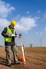 Geodesist measure land look construction plan
