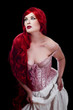 Red haired woman in lingerie over black background
