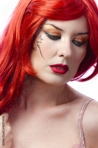 Red haired tattooed woman over white background