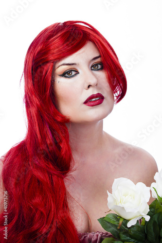 Beautiful red haired with Spring Flowers. Fresh skin concept