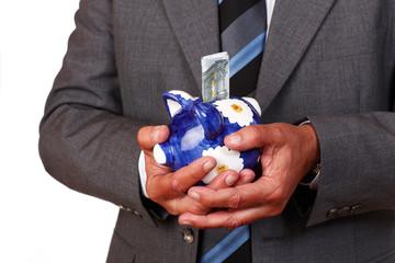 Mann mit Geld und Sparschwein