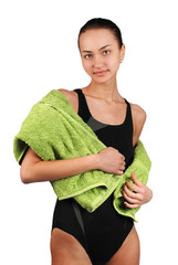 Beautiful young women in swimsuit with green towel