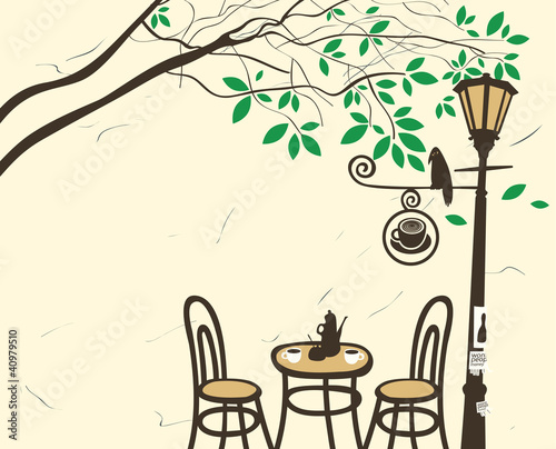 Open-air cafe under a tree with a lantern © paseven