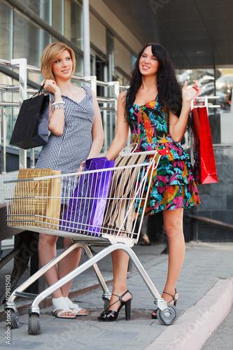 Young women with shopping cart