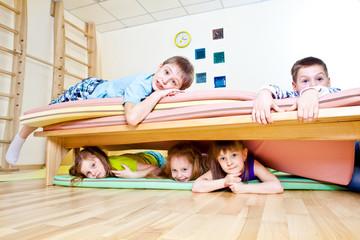 Kids on tumbling mats