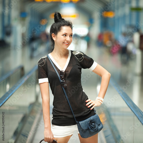 Young pretty woman in the airport