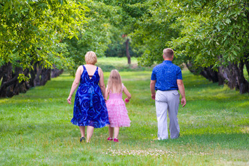 Happy family on the nature on a green grass