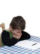 Child struggling with homework.