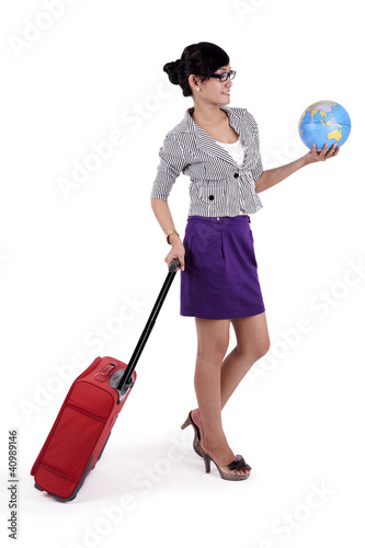 Businesswoman with suitcase and a globe