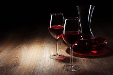 two Wine glass and decanter on a wooden table