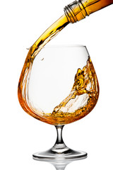 The glass with splashes brandy