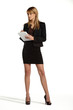 Young attractive business girl standing