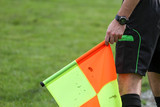 soccer referee hold the flag