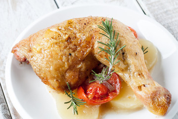 Roast chicken with tomato and onion