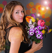 Young, happy woman with a colorful bouquet of spring flowers