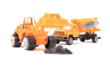 Yellow bulldozer loading stones