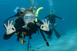 man and woman scuba dive togeather