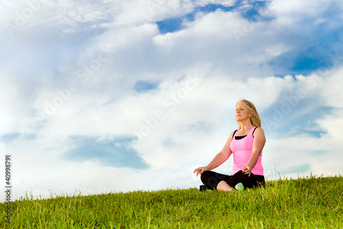 Middle-aged woman in her 40s meditating for exercise outdoors
