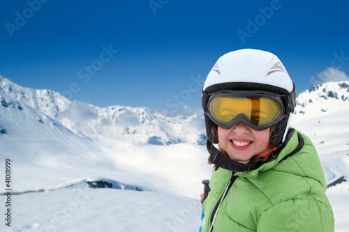 Portrait of little girl with ski outfit