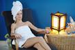 Beautiful young woman in spa
