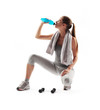 Thirsty young woman drinking after fitness workout