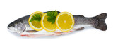 Fresh fish with lemon and parsley isolated on white.