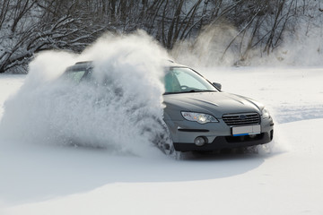 the car is moving rapidly over the smooth snow