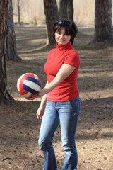 beautiful girl with a volleyball ball