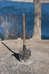 shovel stuck in the ground