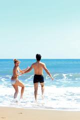 beautiful couple posing on the sea coast