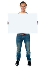 Full length view of man showing blank signboard