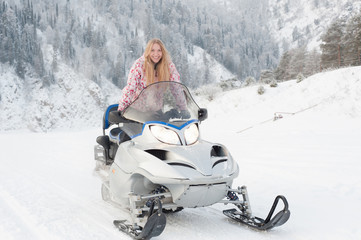 Woman driving a snowmobile