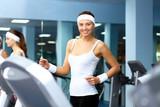 Woman in sport wear doing sport in gym