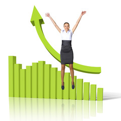 Young woman jumping against financial charts