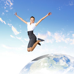 Young woman jumping and our planet earth