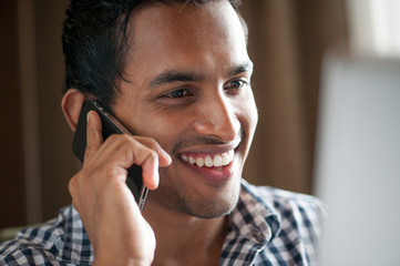Attractive Indian Male on Phone