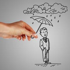 Man under rain holding umbrella
