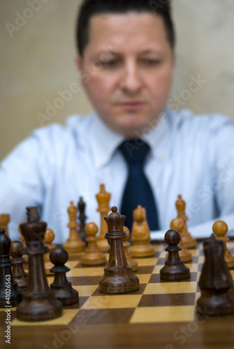 Man playing chess thinking of next move