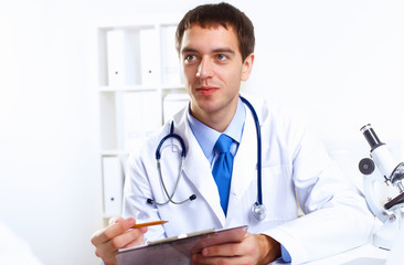 Friendly doctor in medical office