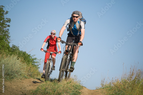 two cyclists biking