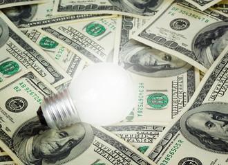 lamp on dollars background