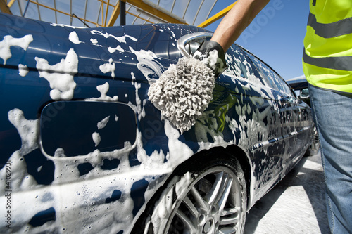Close-up of a man cleaning his car