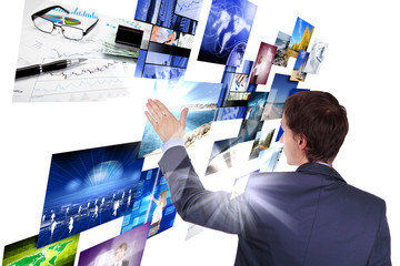 Man working with vurtial screens