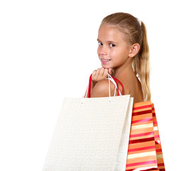 Pretty teenage girl with shopping bags