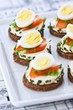 Appetisers with quail eggs and soft cheese
