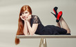 beautiful redhead lay on the table