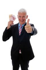 Geschaeftsmann mit Geld und Daumen hoch ganzkoerper