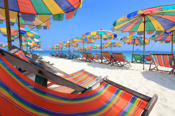 Beach chair and colorful umbrella on the beach , Phuket Thailand